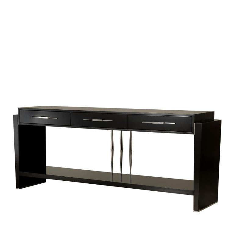 This streamlined console is inspired by Mid-Century Modern design, the squared-off shape of this exquisite console is softened by the glossy finish of the wooden structure and the polished chrome details on the handles of the three drawers and the