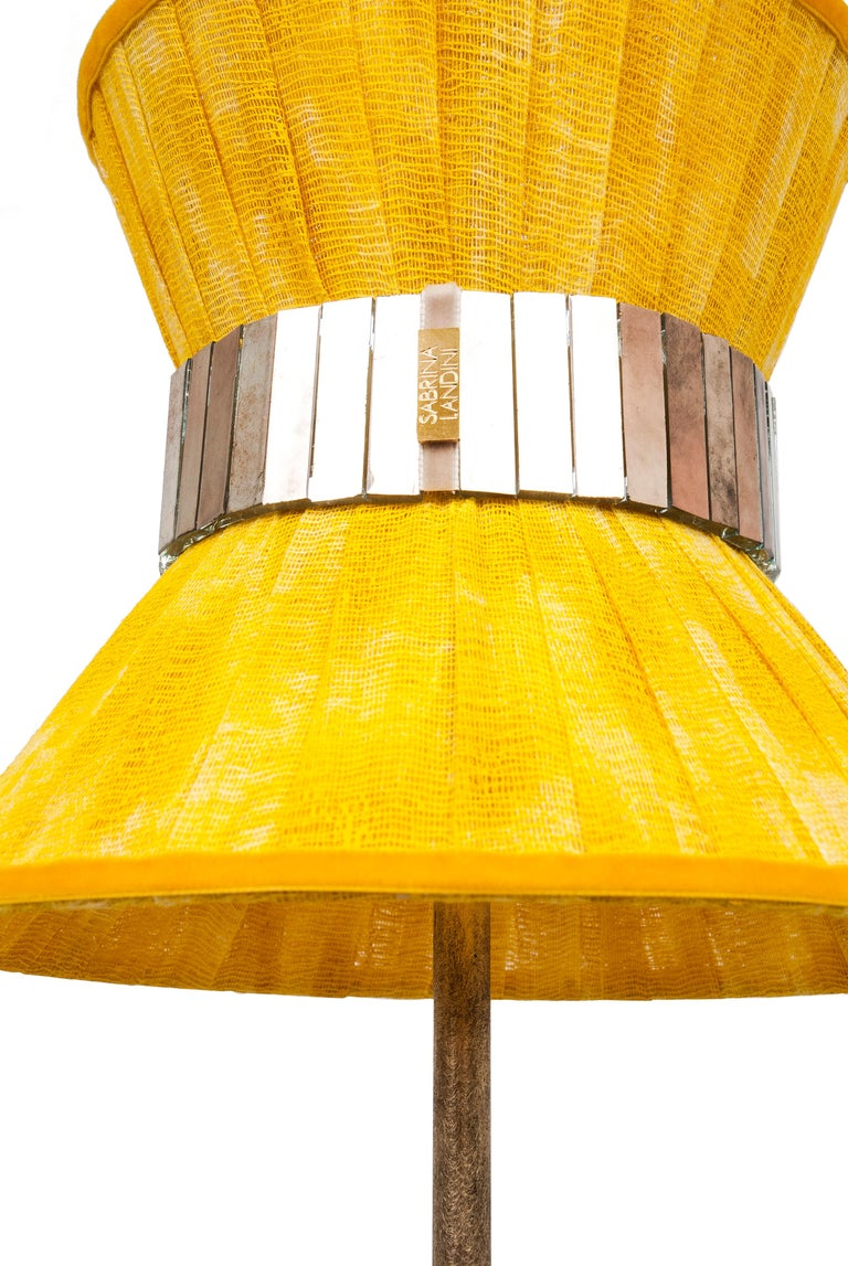 This luminous object is a contemporary piece, entirely made in Tuscany-Italy and 100% of Italian origin. The Tiffany lamp is Sabrina's first creation and is inspired by Audrey Hepburn's timeless charm. Attractive, cross, timeless, beautiful. Many