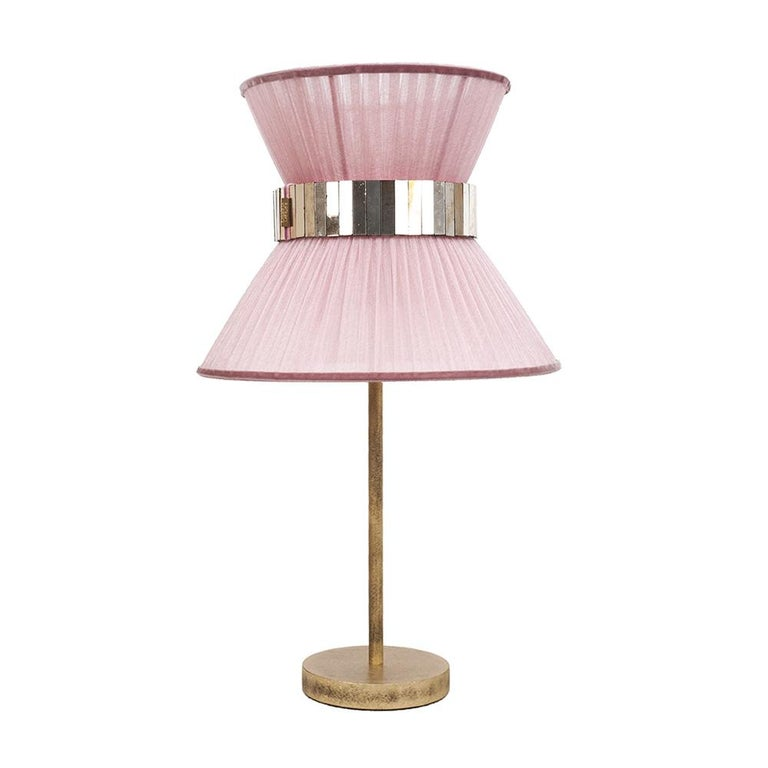 This light object is a contemporary piece, entirely made in Tuscany-Italy and 100% of Italian origin. The Tiffany lamp is Sabrina's first creation and is inspired by Audrey Hepburn's timeless charm. Attractive, cross, timeless, beautiful. Many