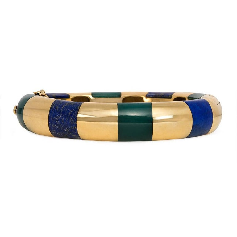 A gold bangle bracelet inlaid with alternating lapis and green onyx segments, in 18k. Tiffany & Co.  Approximately 6