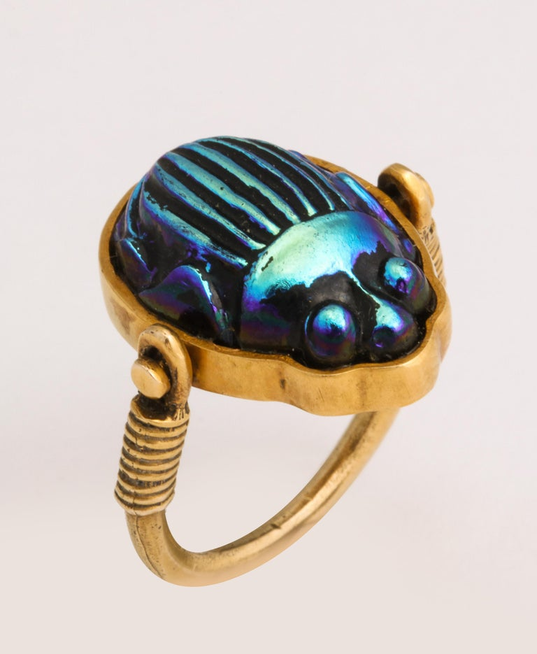Scarab ring mounted in handmade Mounting.  Hand set  Iridescent Scarab which pivots and one can see Hieroglyphs on the reverse.  Set in 14kt Yellow Gold.  Scarab ca 1920-30 - after the Discovery of Tutankhamen's Tomb.  Mounting ca 1970/80 .  Size 5