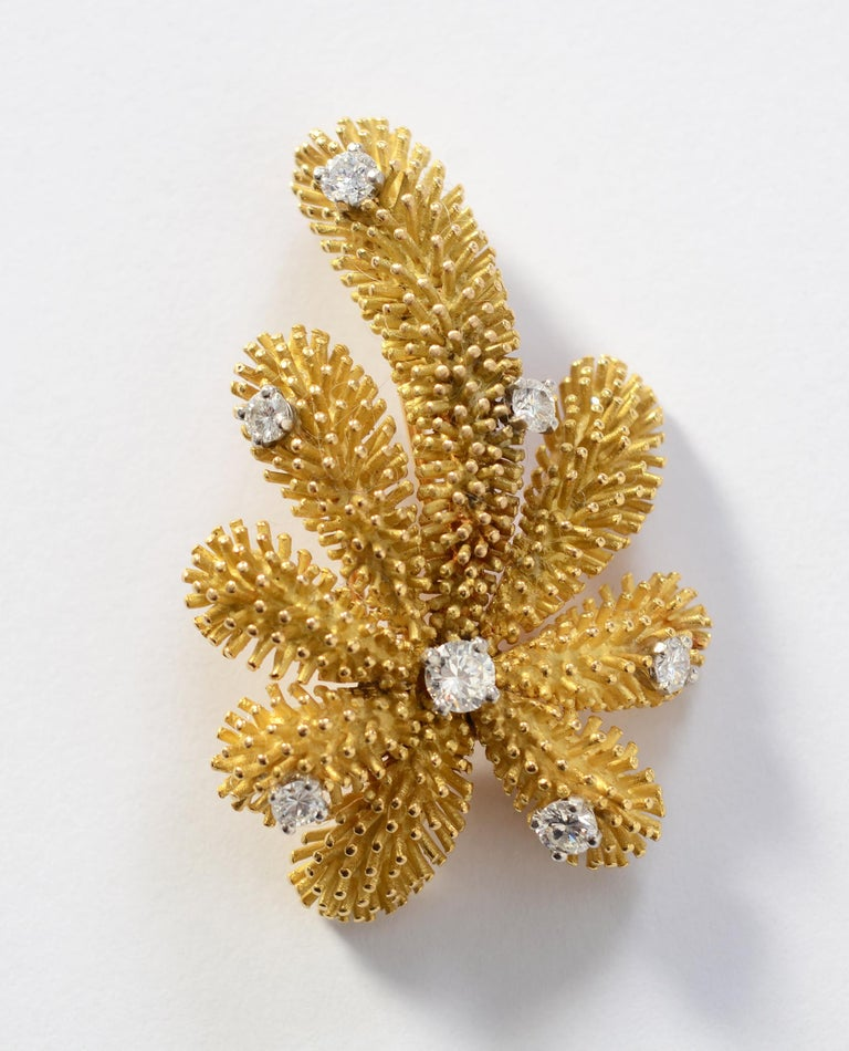 Missing a warm weather vacation this year? This Palm Tree brooch by Tiffany will bring back fond memories. The brooch has a detailed sea urchin texture.  Seven prong set diamonds weigh a total of approximately 1 carat. The stones are H-I color; SI 1