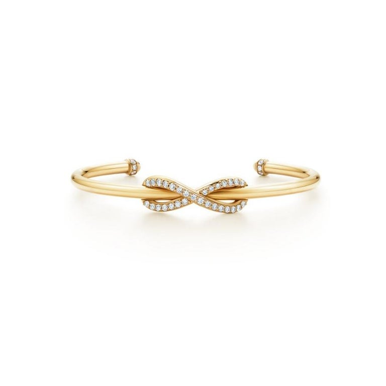 Tiffany & Co. Infinity Yellow Gold Diamond Cuff Medium Size In Excellent Condition For Sale In New York, NY