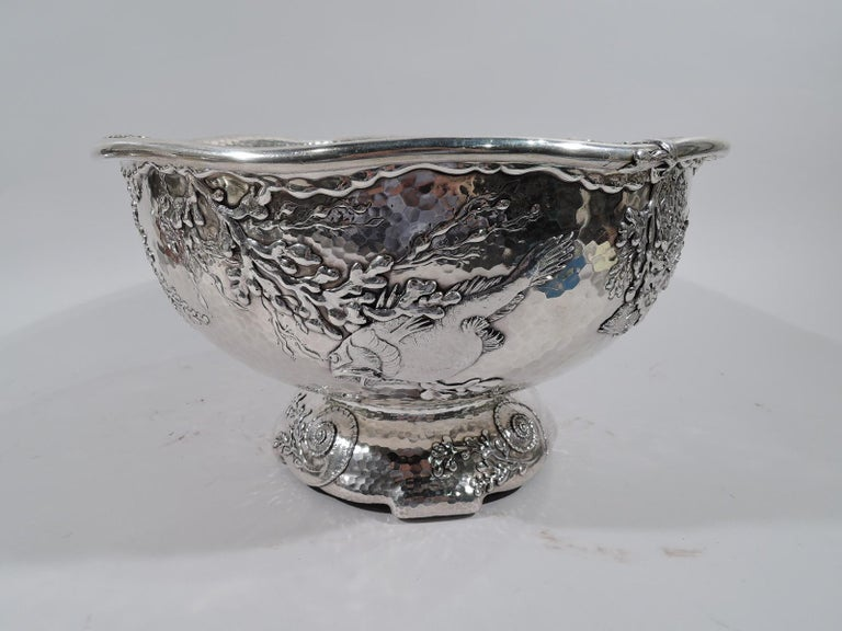 Exquisite Tiffany Japonesque sterling silver centerpiece with applied fish, circa 1881.  Exterior decorated with scaly and gaping fish swimming among drifting, swaying plants. Ornament is applied and chased on honeycomb hand-hammered ground. Fine