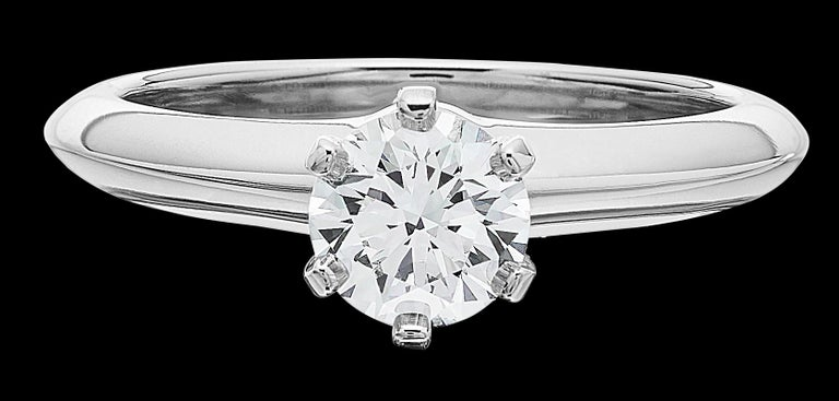 Tiffany® Setting is the world's most iconic engagement ring. The six-prong setting virtually disappears and allows the brilliant diamond to float above the band and into the light, resulting in a ring so beautiful it has been a symbol of the world's