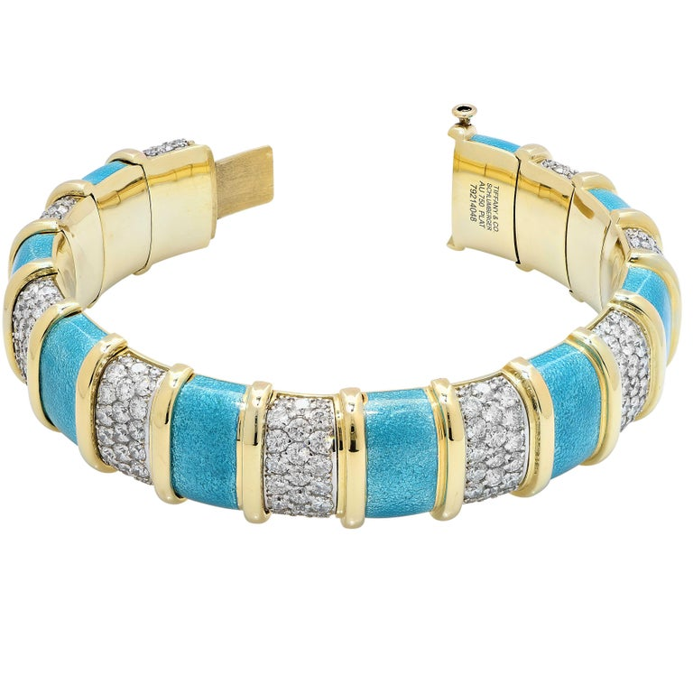 Tiffany Schlumberger Blue Enamel and Diamond Bracelet featuring 9 links with a total of 207 prong set round brilliant cut diamonds with a total estimated carat weight of 20 carats set in platinum and nine panels of blue enamel in 18 karat yellow