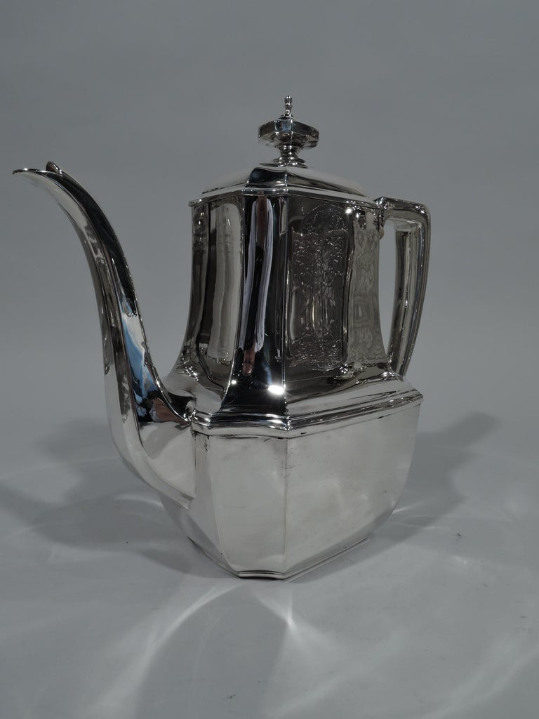 Art Deco sterling silver coffeepot in desirable Hampton. Made by Tiffany & Co. in New York. Rectilinear body with concave corners, faceted s-spout, scroll-bracket handle, and hinged and domed cover with finial. A great piece in the enduringly