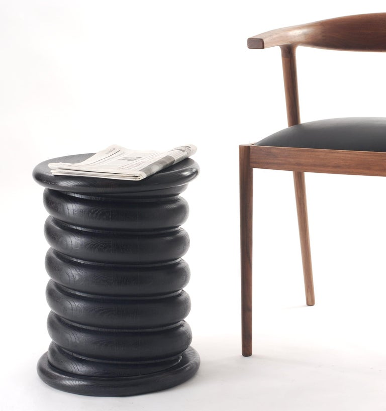 The soft curves of Tiffany stool and its versatility make this piece even more appealing. This modern stool with unique characteristics possesses smooth curves for a more modern and sculptural appeal. It can be a functional piece table for lateral