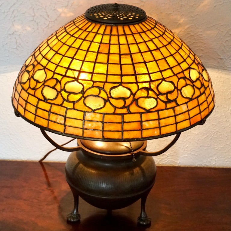 Tiffany Studios leaded glass and bronze acorn table lamp, circa 1910 Art Nouveau - Art Deco transition with semi geometric and patterned acorn decoration.