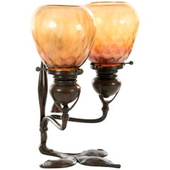 Tiffany Studios Bronze and Favrile Glass Two-Light Fleur-de-Lis Table Lamp