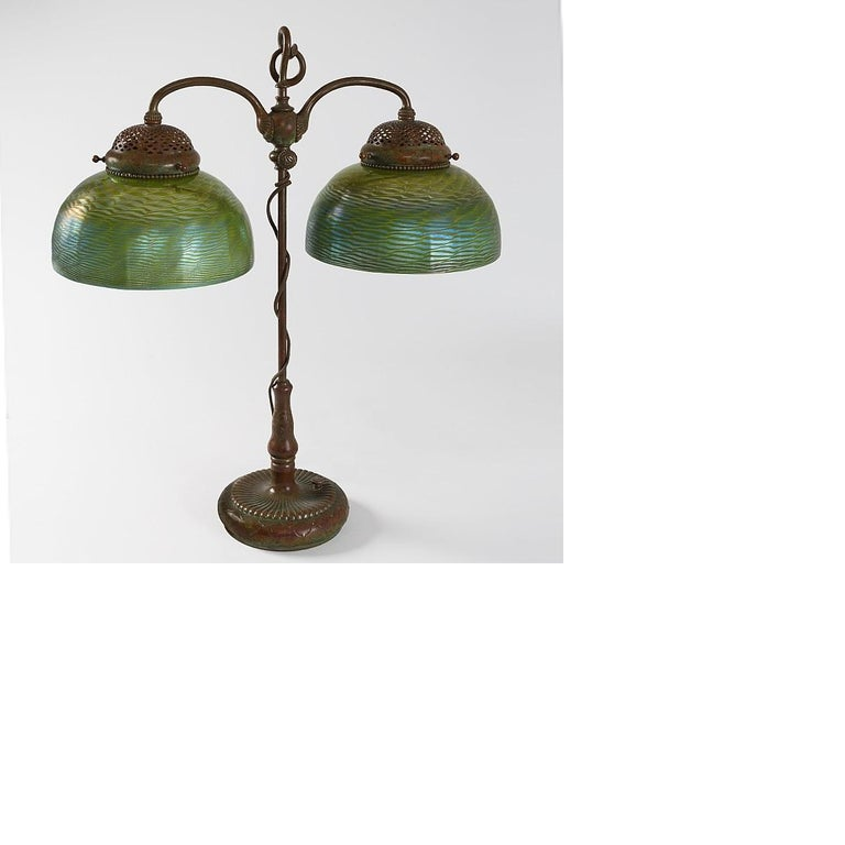 A Tiffany Studios New York patinated bronze and Favrile glass