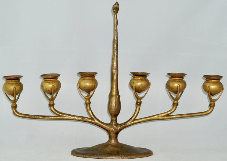 Beautiful Tiffany Studios candelabra, six light form in bronze with center post bearing a fitted candle snuff and extending arms supporting six pod form candle holders with removable bobeches. Original gold doré patina textured. Art Nouveau perfect