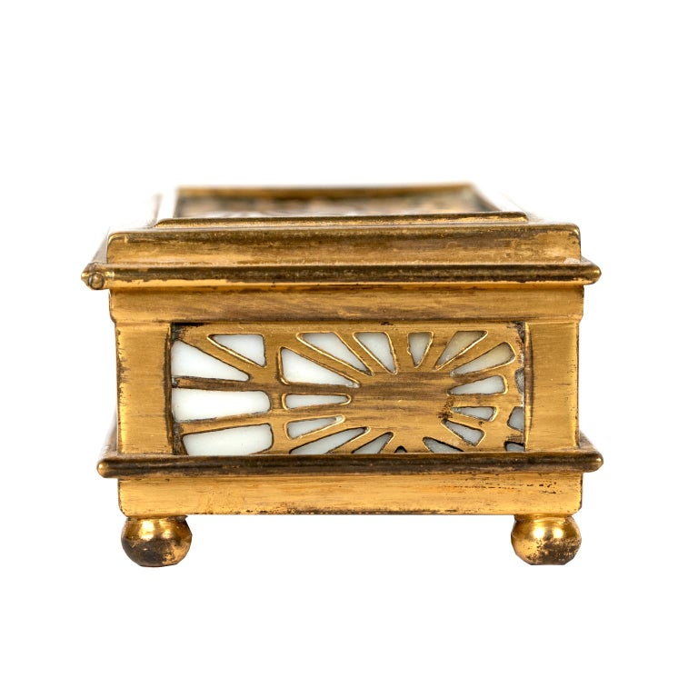 An exquisite Tiffany Studios gold dore pine needle pattern caramel slag glass Stamp box with lift out tray. The base is stamped Tiffany Studios, New York 801.