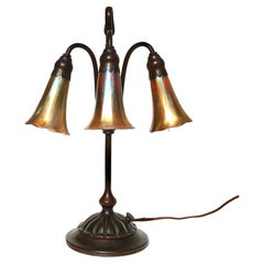Tiffany Studios Three Light Lily Bronze and Favrile Table Lamp