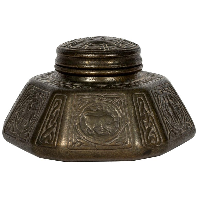 This beautiful collectable from Tiffany Studios, circa 1900s, is in cast metal with a heavily bronze patina. It is stamped on the underside Tiffany Studios 1072. It has its original glass