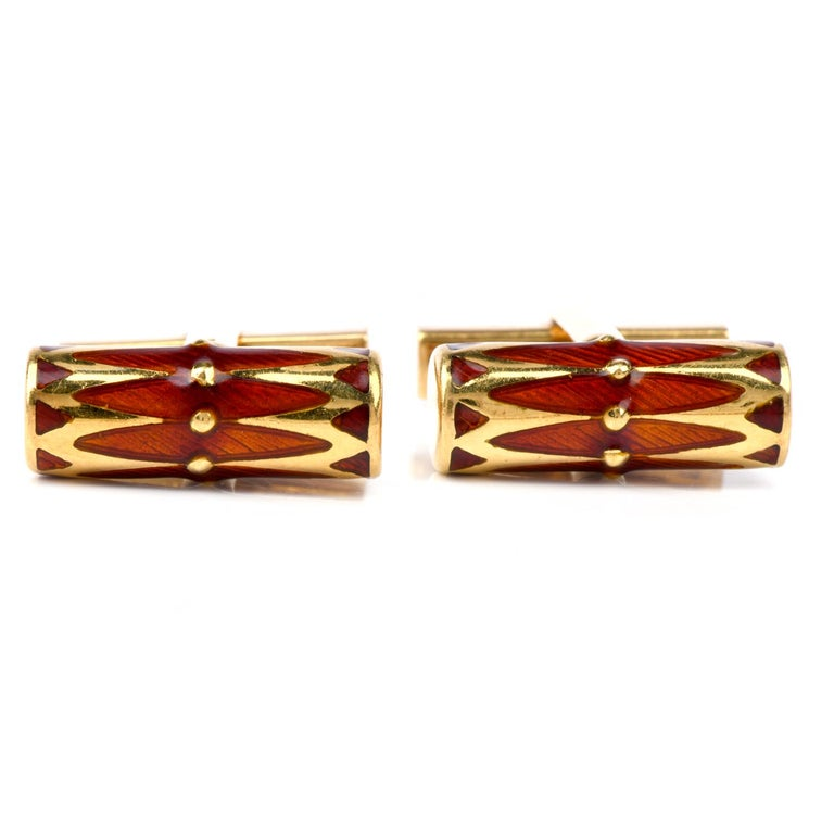 These eye-catching vintage 1970's barrel shaped Cufflinks were crafted in 18K gold. Covering the top and offering a beautiful accent color is  an Orange Red Enamel finish. Measuring appx. 20.0mm x 7.0mm,  Weight; 16.5 Grams These Collectable