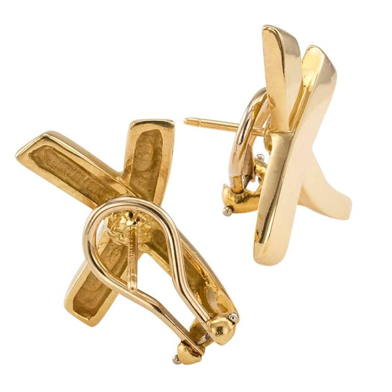 Paloma Picasso graffiti X gold earrings for Tiffany & Co circa 1984. Crafted in 18-karat yellow gold and signed Paloma Picasso Tiffany & Co. Fitted with omega and post backs. Why not make someone happy today? Better yet, reward Yourself! You deserve