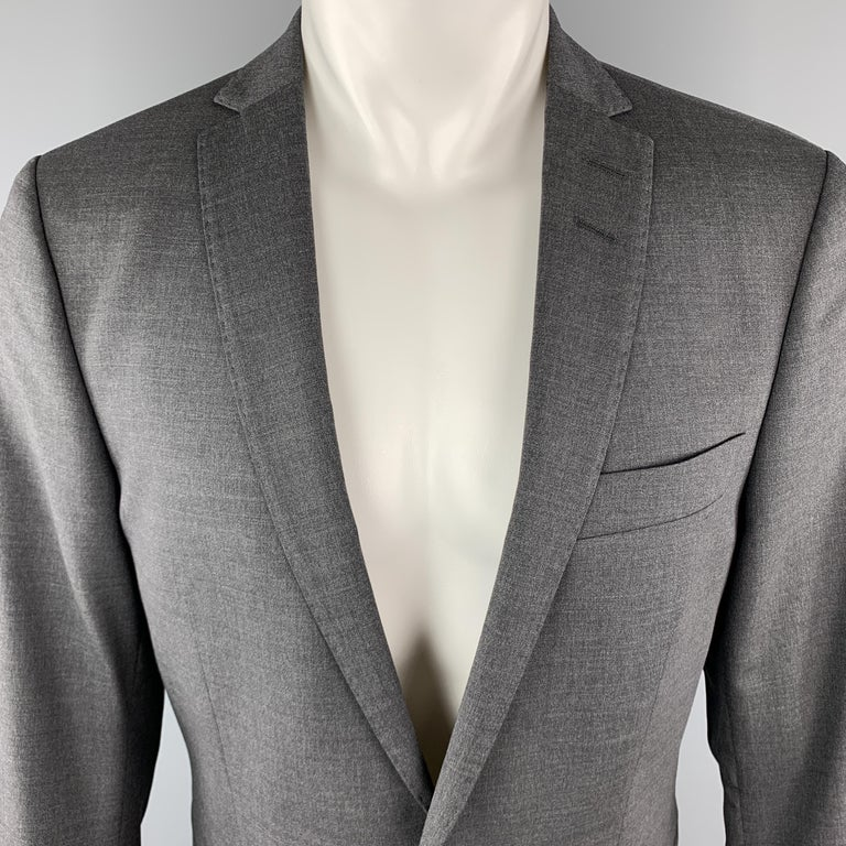 TIGER OF SWEDEN Sport Coat comes in a dark grey tone in a solid wool material, with a notch lapel, slit and flap pockets, two buttons at closure, buttoned cuffs, and a double vent at back. Made in Romania.  New With Tags. Marked: IT