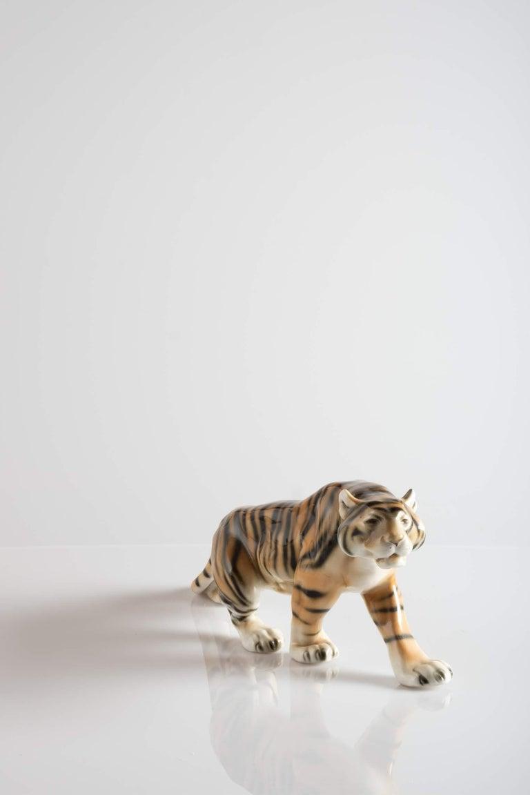 Elegant porcelain sculpture depicting a sumptuous tiger.