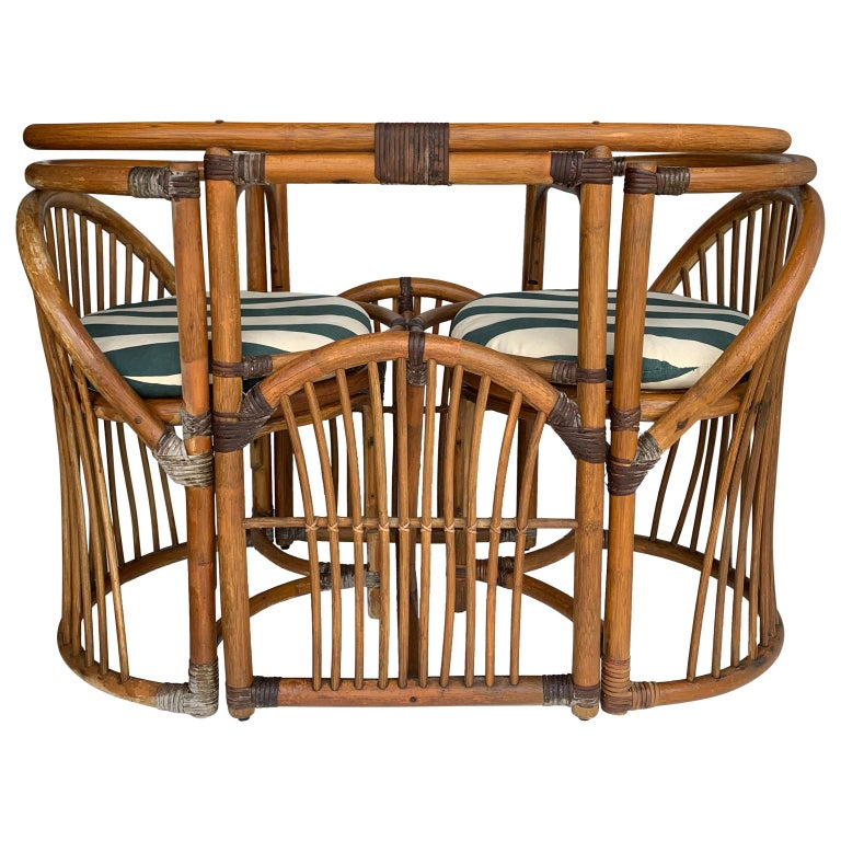 Patio dining table and two chairs, made in tiger wood bamboo rattan  Glass table-top ships separately, free of charge and is offered in two different versions: A: 24