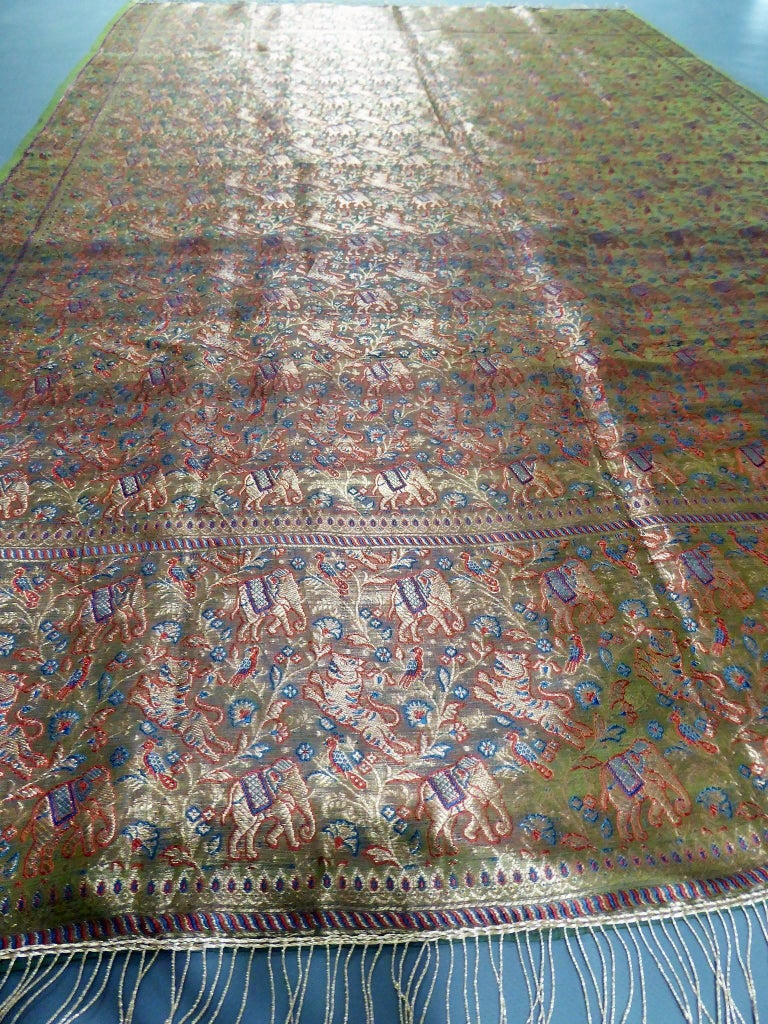 Before 1950  India for the domestic market   Superb long silk woven shawl made in India for the domestic market probably around 1920/1930. Shawl with a background full of decorations of elephant and tiger garlands, separated at the ends by a red and