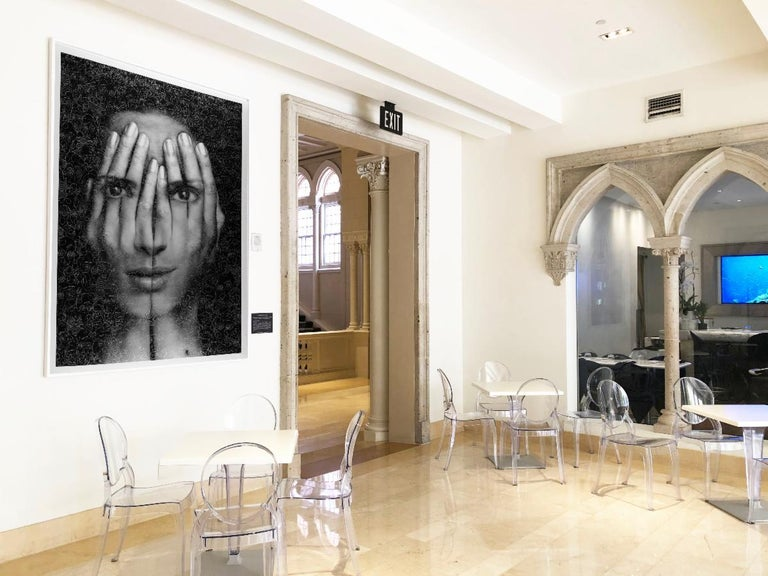 "framed in white, 85x61 inches.  New York-based, Armenian-born artist, Tigran Tsitoghdzyan, is especially interested in how people interact in this new era of technology and social media. His ""Mirrors"" series suggest a close examination of self, and"