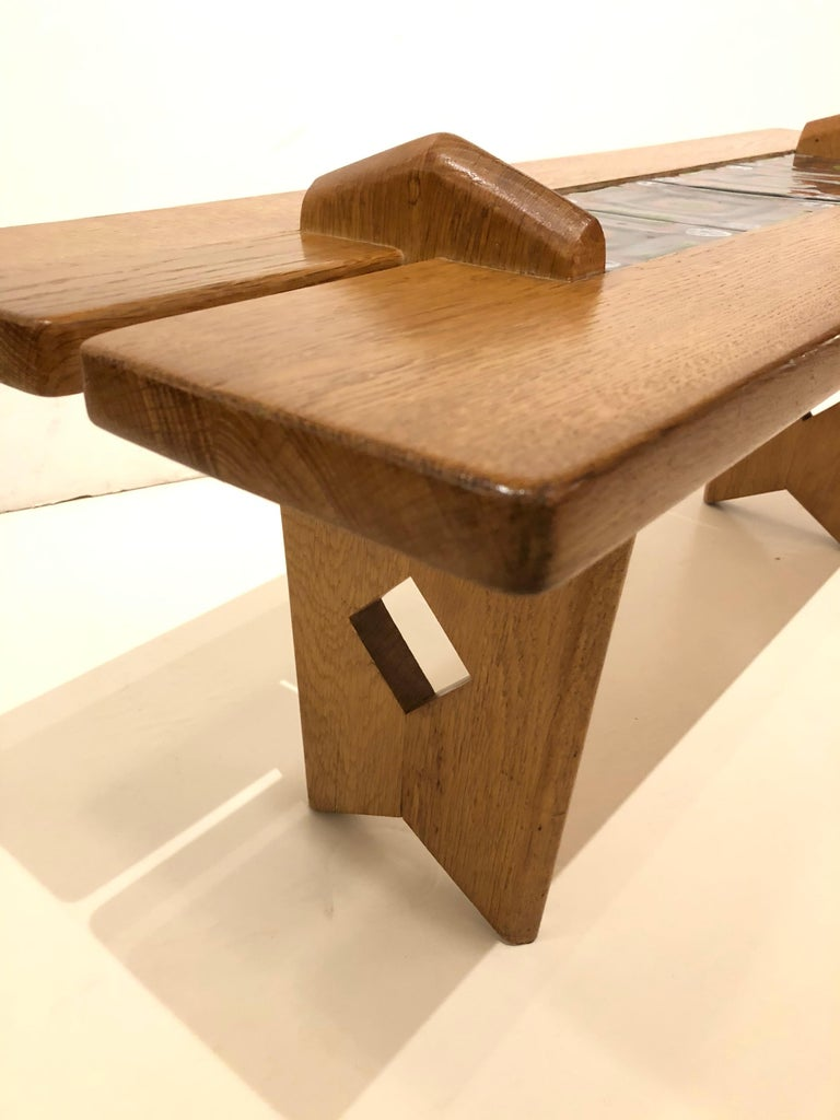 Tile top table by Guillerme et Chambron. Oak table featuring 4 original ceramic tiles.