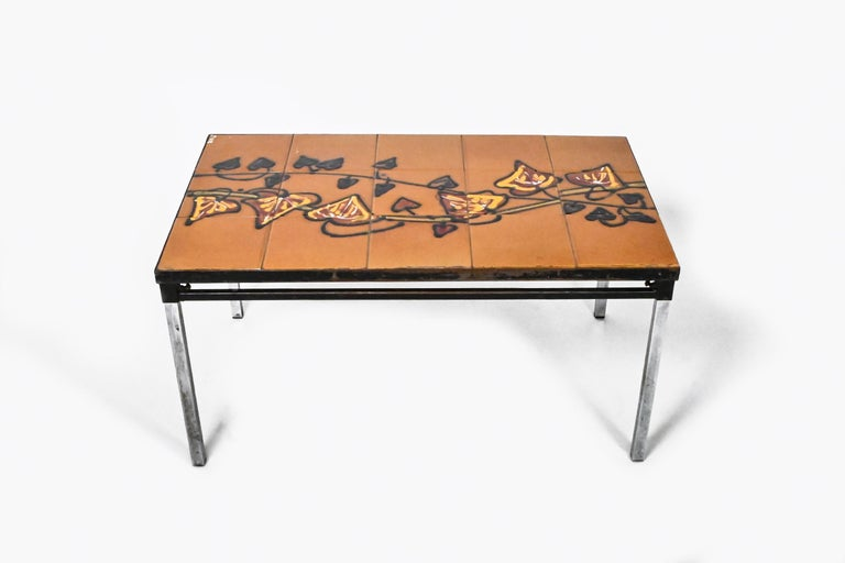 A Midcentury Tiled coffee table by Adri Belgique is out for sale. This is a well-known signature piece of the 1960s era Belgian design production.
