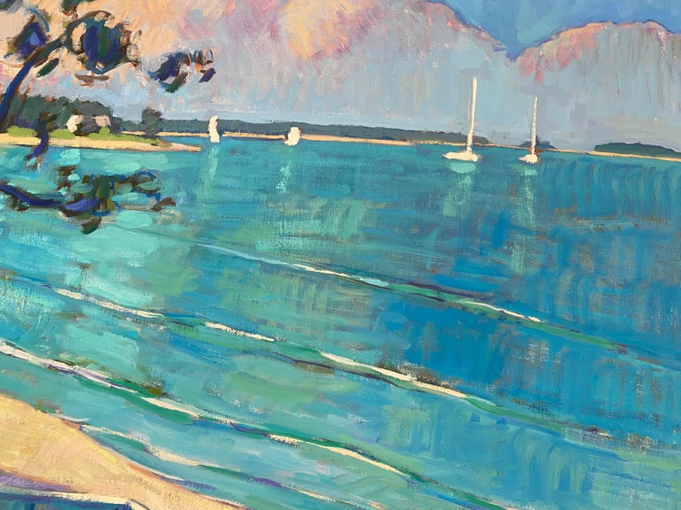 Framed dimensions: 40.5 x 48.5 inches Painting dimensions: 39 x 47 inches  An oil painting of a a small row-boat resting in the shadows on a quiet beach in Sag Harbor. Bright blue sea expands from the foreground, and sailboats lie along the horizon,