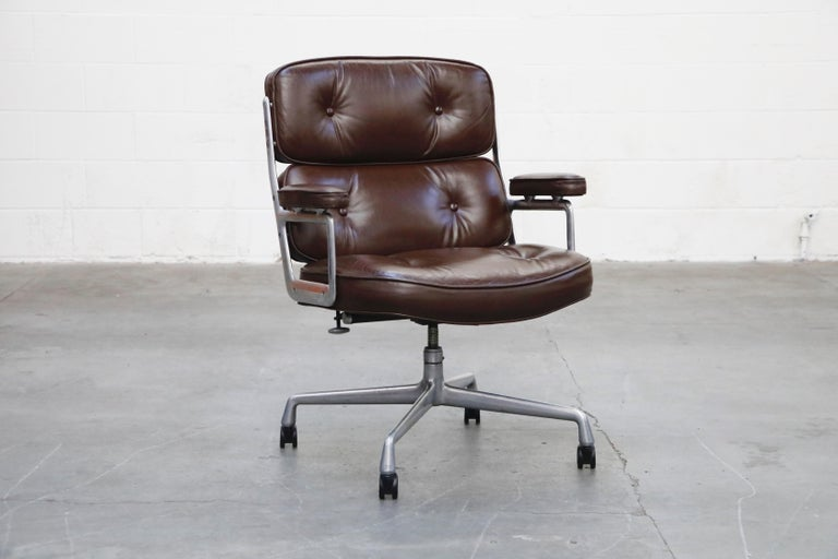 These incredible deep brown leather 'Time Life' executive swivel desk chairs were designed by Charles and Ray Eames in 1959 and manufactured by Herman Miller. Known to be the most comfortable and ergonomic executive chair, these Time Life Executive