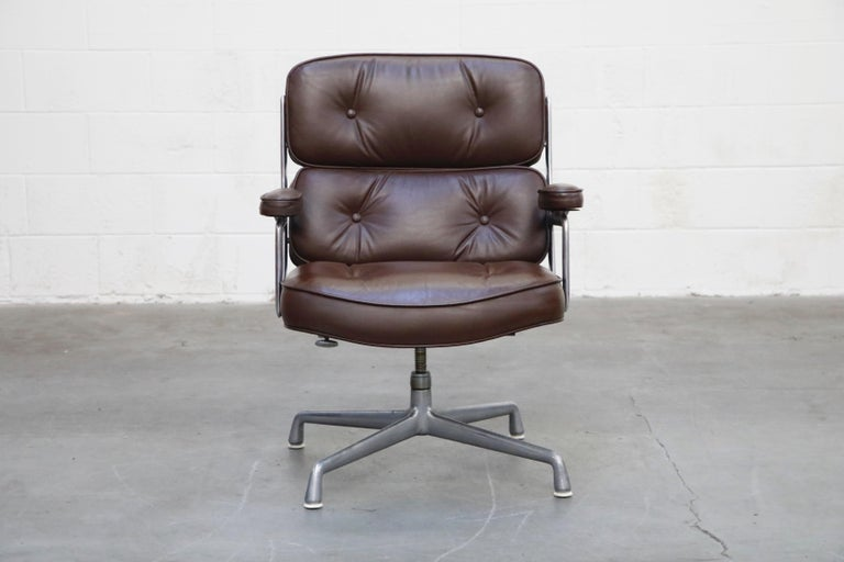 These incredible deep brown leather 'Time Life' executive swivel lounge chairs were designed by Charles and Ray Eames in 1959 and manufactured by Herman Miller. Known to be the most comfortable and ergonomic executive chair, these Time Life