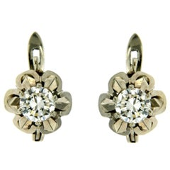 Timeless 1 carat Diamonds Gold Solitaire Stud Earrings