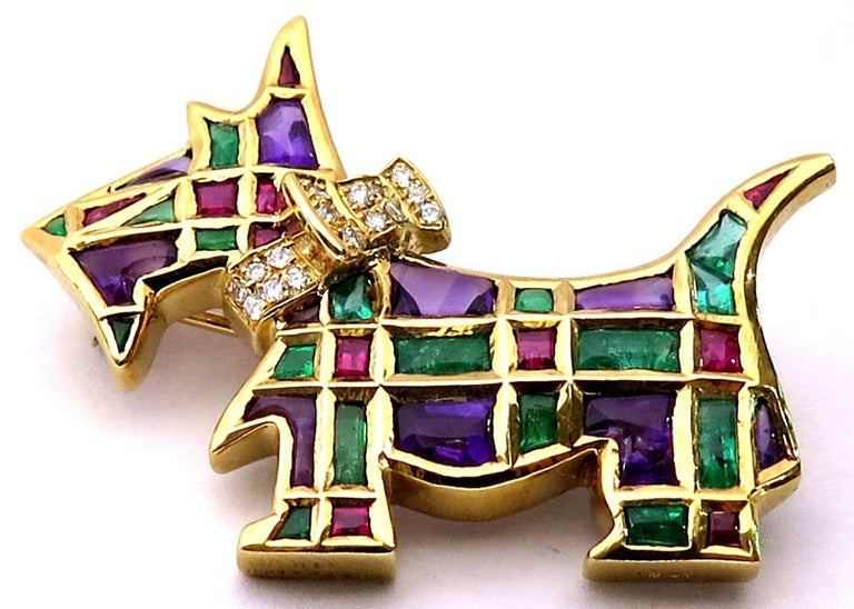 This fabulous little fella is so adorable, you will want to take him home for yourself! He is 18k yellow gold and accented with diamonds, rubies, emeralds, and amethysts all cabochons, calibrated perfectly into his irresistibly shaped body. He is