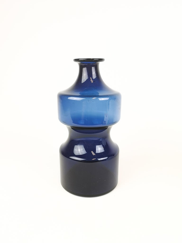 A great looking blue vase created by Timo Sarpaneva for Iittala in the 1970s. Singed T.S under bottom.  Measures: H 25 cm, D 13 cm.