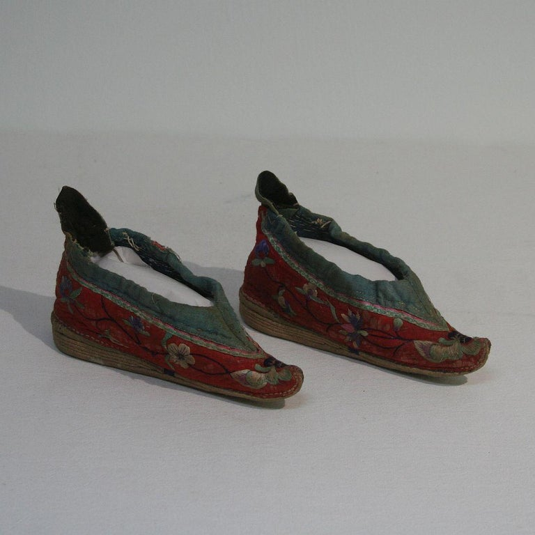Very rare tiny 19th century Chinese embroidered women's shoes, China, 19th century. Weathered.