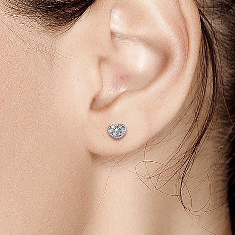 Fourteen karat white gold tiny diamond stud earrings Heart shape studs measuring 0.25 inch Round diamond weighing 0.14 carat  Diamond quality H SI New Earrings Handmade in USA