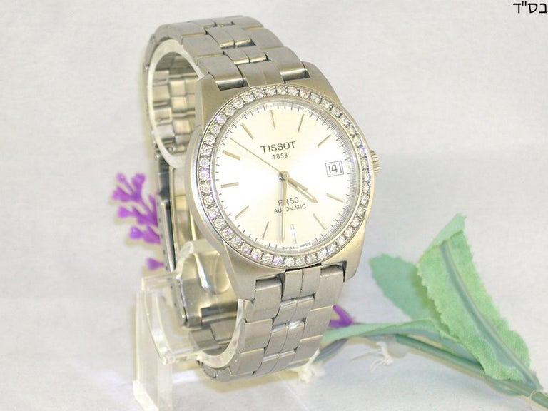 Tissot PR50 ref: J374/474  Automatic  Stainless steel  total weight: 90,07gr.  Diamonds: 1,38ct. color: G clarity: VS2  diameter: 38,00mm  length bracelet: 17,5cm.  age: ca. 2000-2005  Perfect condition  Free insured shipping worldwide  All our
