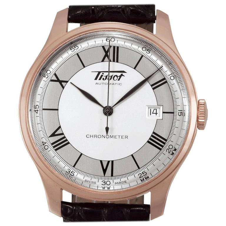 Case No. 0052, Ref H700333. Made circa 2000. Fine, water-resistant, self-winding, 18K pink gold wristwatch with date and 18K pink gold Tissot double deployant clasp. Case two-body, polished and brushed, domed bezel, transparent case back, curved