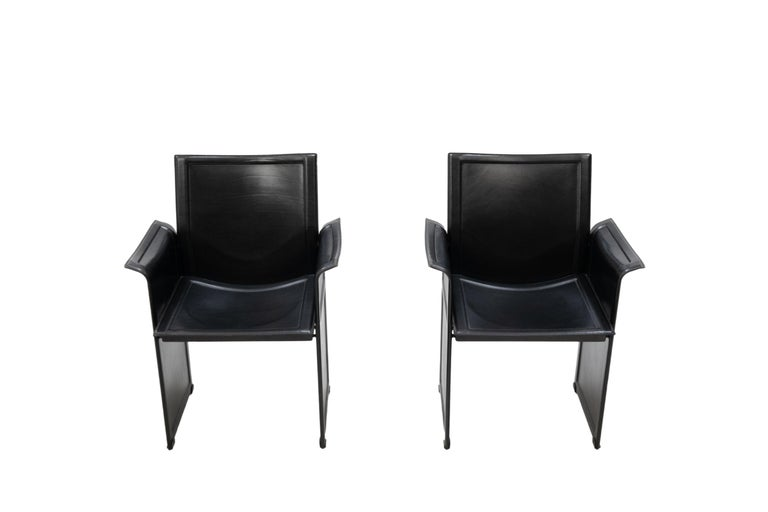 Tito Agnoli for Matteo Grassi chairs. Model Korium. Love these chairs completely covert with thick black leather. Such a good Design Signed. Good condition.