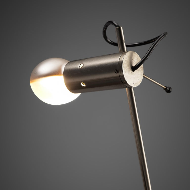 Tito Agnoli for O-Luce, desk light 'Cornalux', metal, Italy, 1964.  Modern table lamp designed by Tito Agnoli. The light bulb has a reflector inside and the frame is made of steel which gives the lamp its minimalistic look. A very versatile design