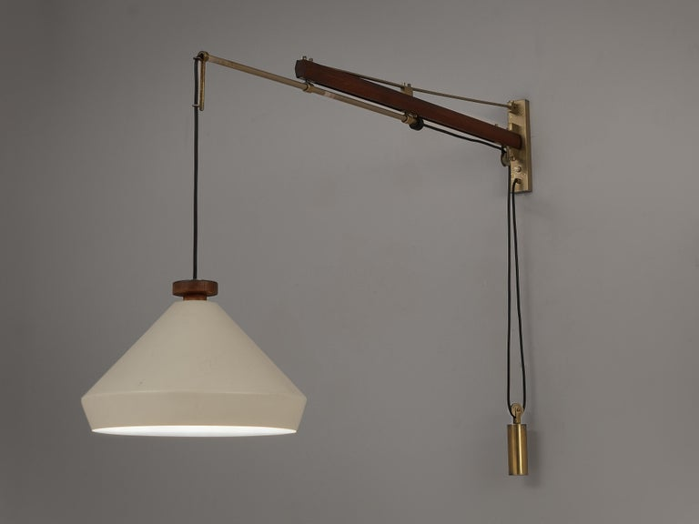 Tito Agnoli for O-Luce, wall light, white lacquered metal, teak, cord and brass, Italy, circa 1950.   Impressive wall mounted designed by Tito Agnoli, and manufactured by O-Luce in circa 1950. This lamp is made of teak, lacquered metal and brass.