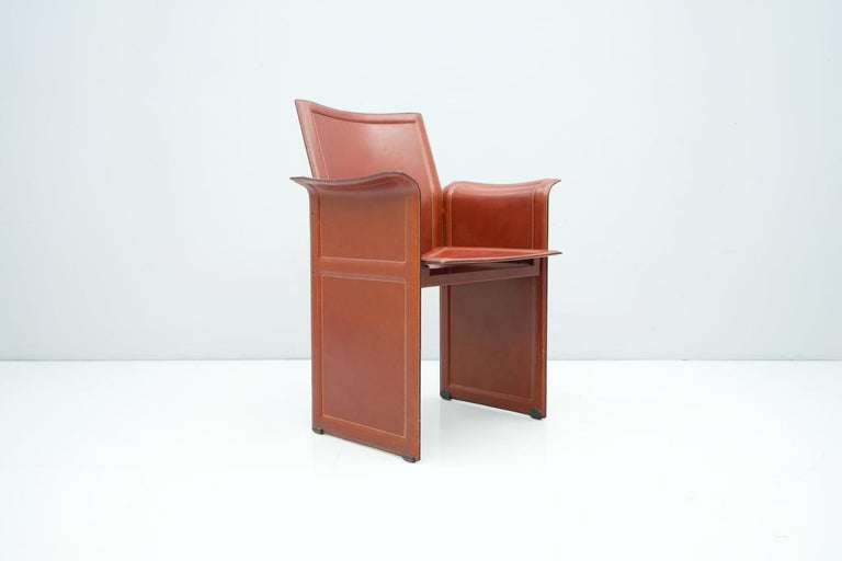 Tito Agnoli Korium chair for Matteo Grassi, 1970s in a great red brown leather. Measures: H 86 cm, W 64 cm, D 52 cm, SH 45 cm. Good condition with very nice patina.