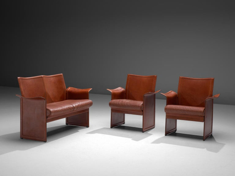 Tito Agnoli for Matteo Grassi, Korium living room set, leather and metal, Italy, 1970's  These sophisticated iconic Korium cognac leather chairs and sofa were designed by Tito Agnoli for Matteo Grassi. It features a strong structure, with a wing