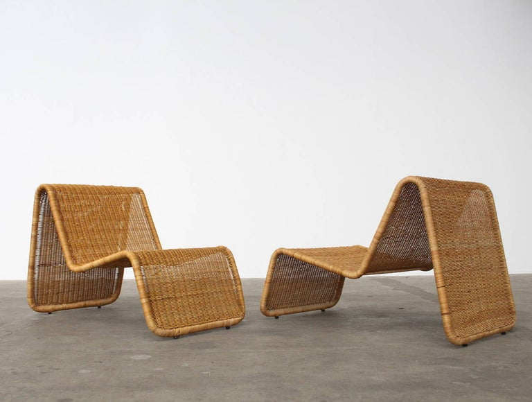 Wonderful sculptural lounge chairs designed by Tito Agnoli for Bonacina. Tubular lacquered steel frame with woven wicker. This model can be used both indoors and outdoors. Before shipping the chairs will have a professional anti-weather treatment