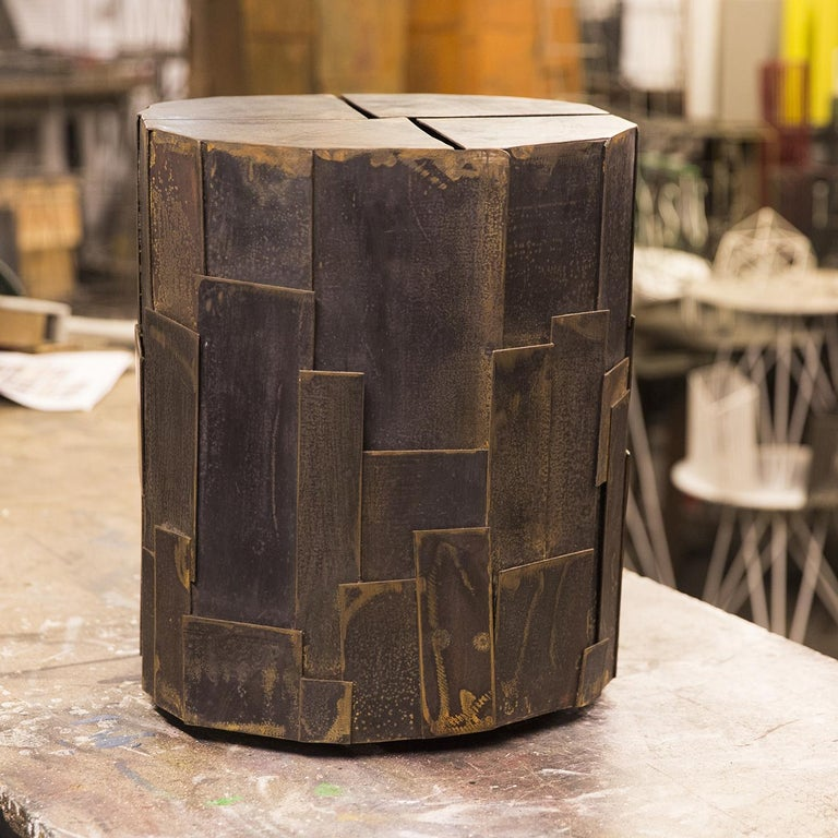 Sculptural side table in treated iron sheet by Sciortino. The metalwork is painted black, with a rough finish that lends the work an air of industrial. Measurements and finish may vary slightly due to the artistic nature of Sciortino's
