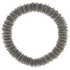 Tiziana N1 Stainless Steel Spring Bangle Bracelet