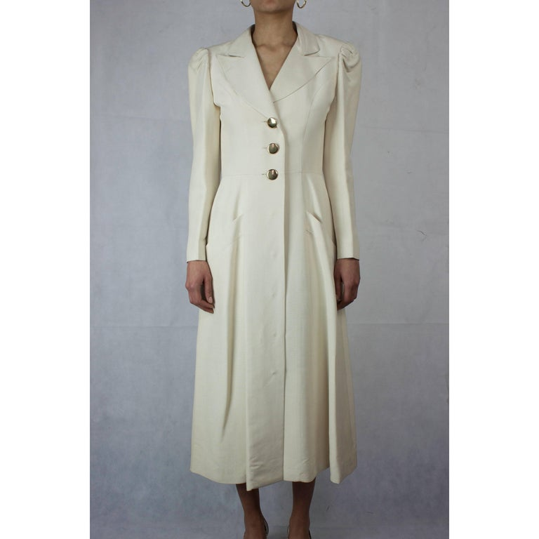 In the 1960s formal wear had a fresh new look.  Simpler and straighter lines inspired by military and ecclesiastical tailoring signalled the beginning of modern and contemporary fashion. This elegant coat inspired by the full length garment worn by