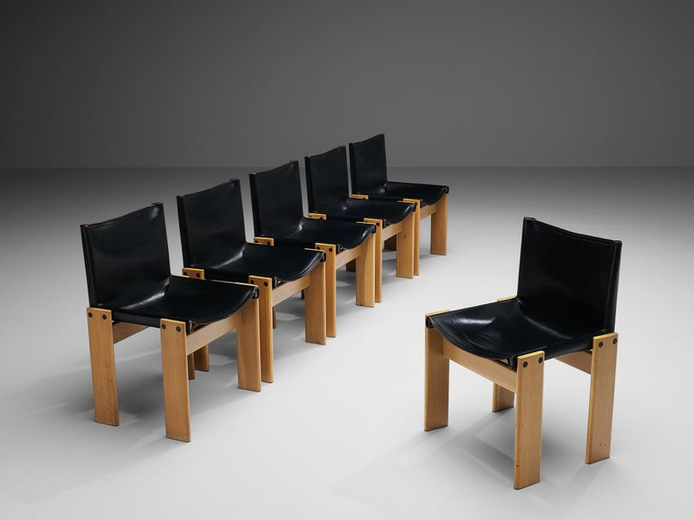 Afra & Tobia Scarpa for Molteni, set of six 'Monk' dining chairs, oak, black leather, Italy, 1974  Afra & Tobia Scarpa designed the 'Monk' chairs for Molteni in 1974. The black leather forms a striking combination with the blond wood. Interesting