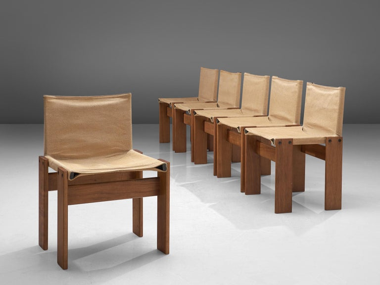 Afra & Tobia Scarpa for Molteni, set of six 'Monk' chairs, walnut and beige canvas, Italy, 1974.  The natural canvas forms a striking combination with the warm walnut wood. Interesting is the 'flat' shape of this chair where the designer has