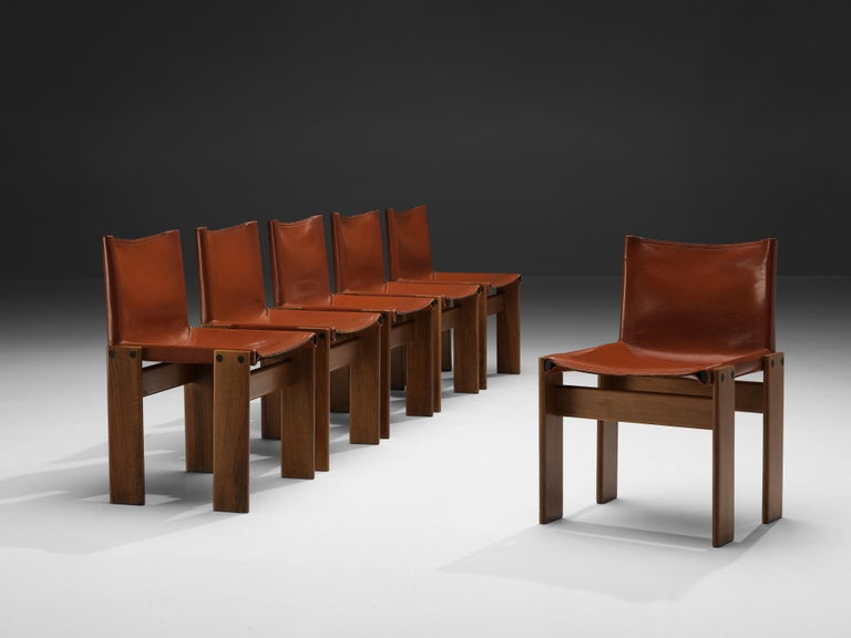 Afra & Tobia Scarpa for Molteni, set of six 'Monk' dining chairs, walnut, red leather, Italy, 1974  Afra & Tobia Scarpa designed the 'Monk' chairs for Molteni in 1974. The red leather forms a striking combination with the beautifully grained